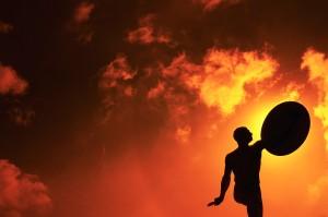 Warrior Statue Silhouette and Orange Sky