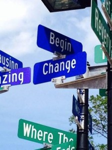 Street signs say Begin and Change